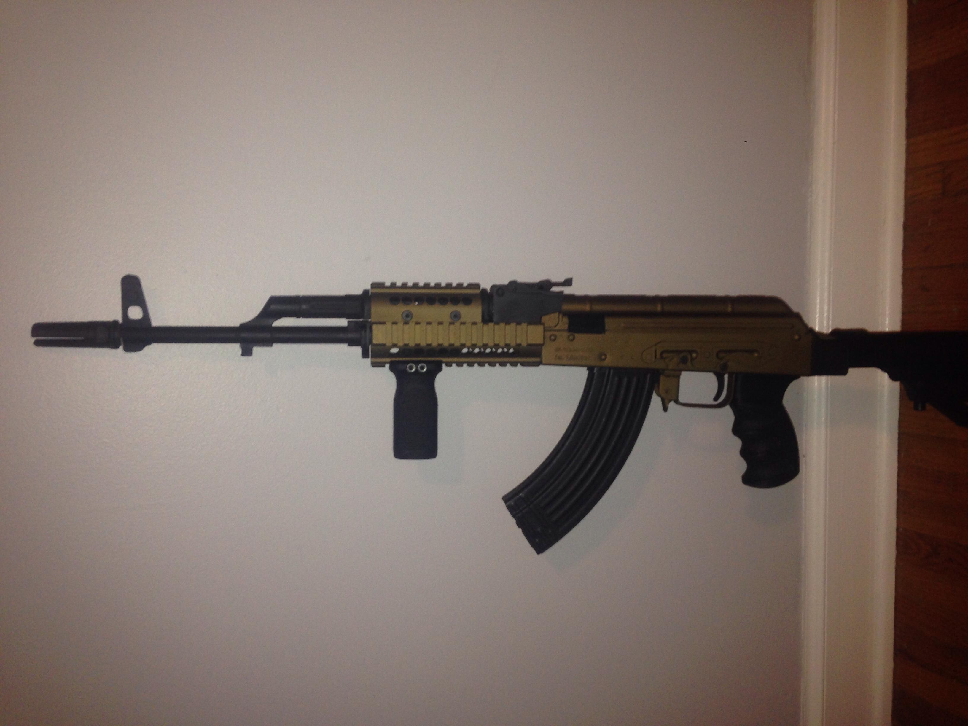 Wasr-10 Gp-Wasr 10-63, Cerekote gold, Sure fire flash hider, Jard trigger, Phoenix buffer tube stock, ATI pistol grip